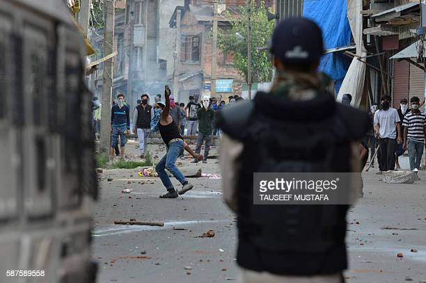 TOPSHOT Kashmiri protesters throw stones towards Indian government forces during a protest against the civilian killings in Kashmir's ongoing unrest...