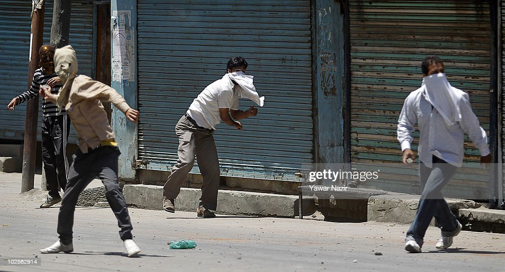 Kashmiri protesters throw stones towards Indian policemen during an anti India protest after they defied a strict curfew on July 01 2010 in Srinagar...