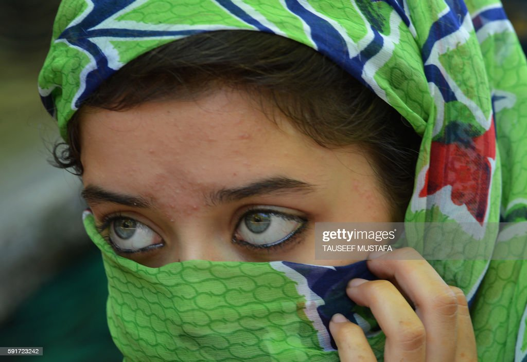 Kashmiri protestor looks on during a protest against civilian killings in Kashmir's ongoing summer unrest during a curfew in the Batmaloo area of...