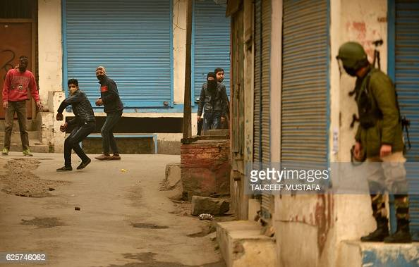 Kashmiri protestors clash with Indian government forces after the Friday prayer in Jamia Masjid in downtown Srinagar on November 25 2016 Authorities...
