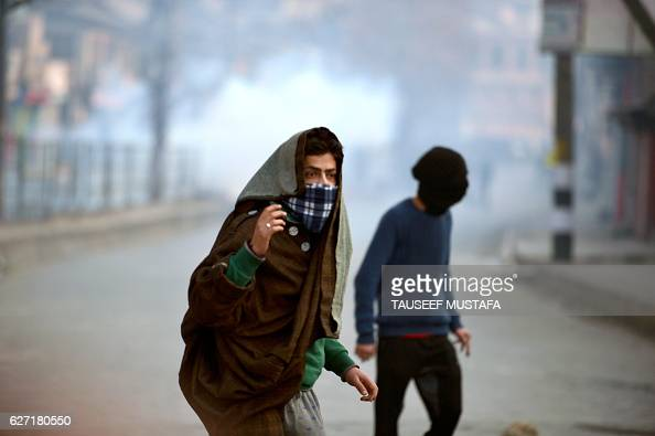 Kashmiri protestors clash with Indian police during a rally in downtown Srinagar on December 2 2016 Kashmir's chief priest and chairman of All...