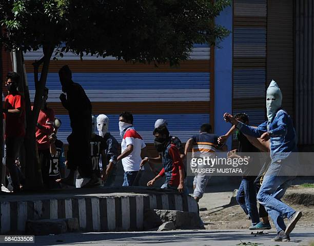 TOPSHOT Kashmiri protestors clash with Indian security forces in downtown Srinagar on July 28 2016 Indian Kashmir has been tense following the death...