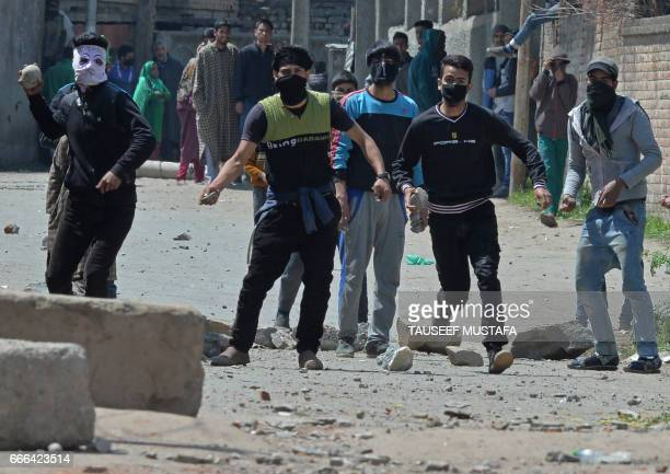 Kashmiri protestors clash with Indian security forces near a polling station in Srinagar on April 9 2017 Three civilians were killed in...