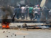 Kashmiri protestors run from Indian police during clashes in Srinagar on July 23 2016 Large parts of Indianadministered Kashmir have been under...