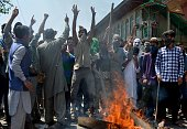 Kashmiri protestors shout profreedom and antiIndian slogans as unseen Indian police look on in Srinagar on July 23 2016 Large parts of...