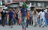 Kashmiri protestors shout proindependence and antiIndia slogans as they march towards Srinagar's downtown Lal Chowk area on July 26 before being...