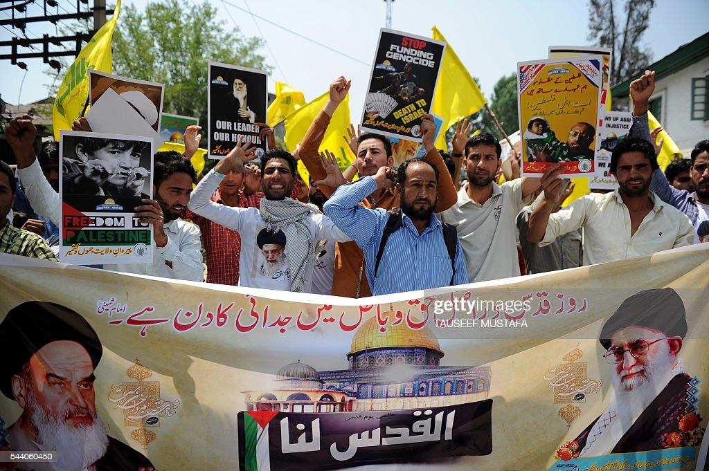 Kashmiri protestors wave Hezbollah flags as they shout anti-US and anti-Israel slogans during a protest to mark the International Quds Day in Srinagar on July 1, 2016. = Kashmiri Shia Muslims observe International Quds Day as an annual event held on the last Friday of Ramadan that was initiated by Iran in 1979 to express solidarity for the Palestinians and oppose Israel's existence, as well as Israel's control of Al Aqsa Mosque and Jerusalem. MUSTAFA