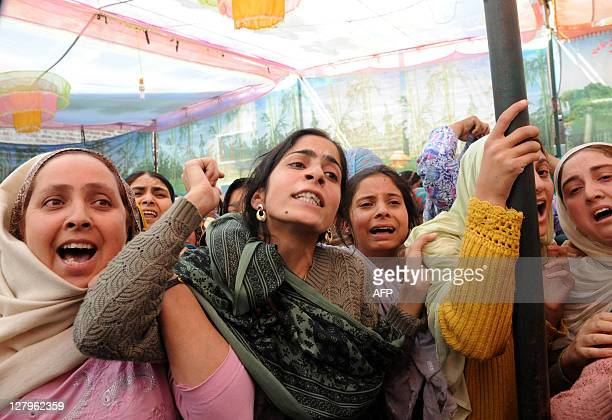 Kashmiri relatives mourn during the funeral ceremony of Sayeed Mohammad Yousuf a retired teacher and National Conference party worker who allegedly...