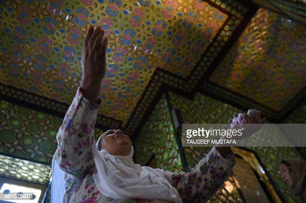 Kashmiri resident prays inside the Sheikh Abdul Qadir Geelani shrine in downtown Srinagar on June 1 2017 Muslims throughout the world are marking the...
