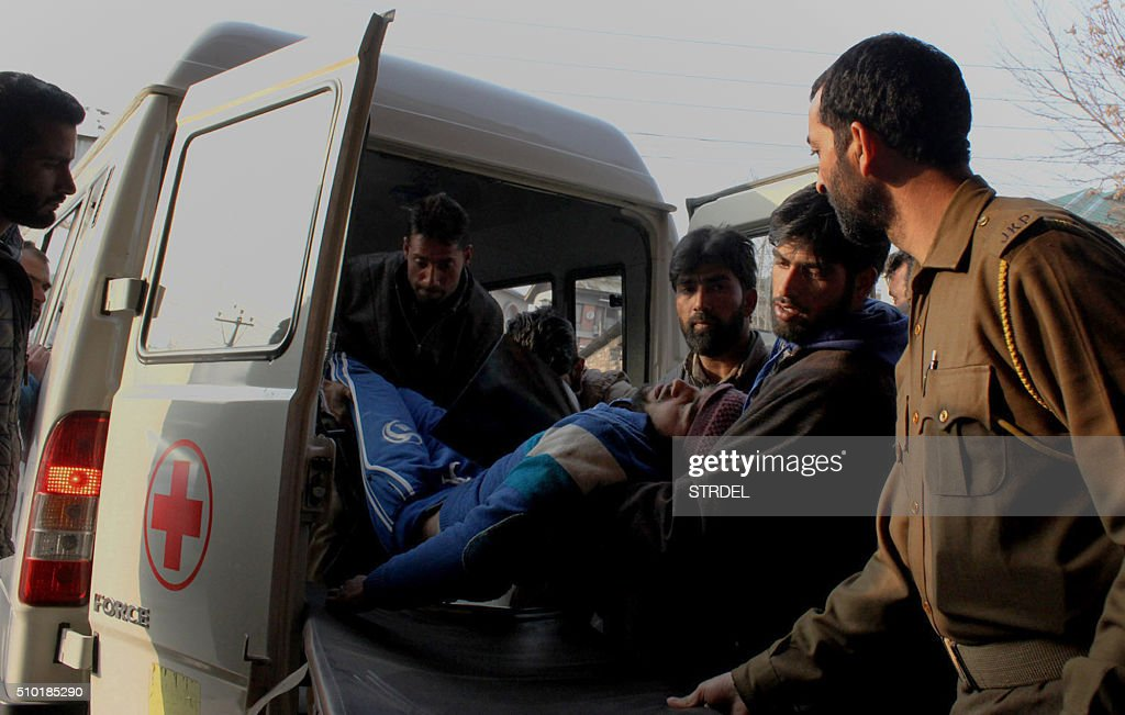 Kashmiri residents bring a man injured in a gun fight for treatment at a local hospital in Srinagar on February 14, 2016. Two civilians were killed and several wounded during protests in the restive Indian-administered Kashmir February 14, after a gun fight broke out between rebels and government forces, police said. The gun battle was triggered after government troops -- suspecting the presence of armed rebels -- cordoned off the village of Kakpora, some 35 kilometres south of the main city of Srinagar. AFP PHOTO / STR / AFP / STRDEL