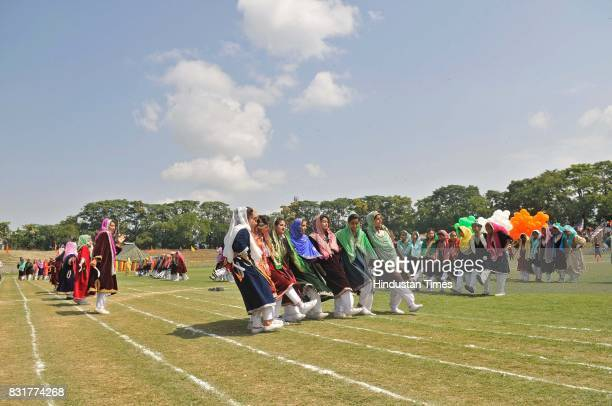 Kashmiri school girls dance on the occasion of 71st Independence Day Celebrations on August 15 2017 in Srinagar India Mufti welcomed Prime Minister...