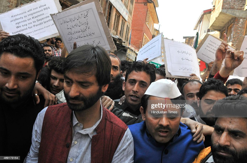 Kashmiri separatist leader and JKLF chairman <a gi-track='captionPersonalityLinkClicked' href=/galleries/search?phrase=Yasin+Malik&family=editorial&specificpeople=691200 ng-click='$event.stopPropagation()'>Yasin Malik</a> along with Kashmiri Pandits during a protest march against the government plan to build townships for Kashmiri Hindus on April 10, 2015 in Srinagar, India. Nearly 200,000 Hindus have fled from Kashmir Valley after the outbreak of Islamist militancy in 1989.