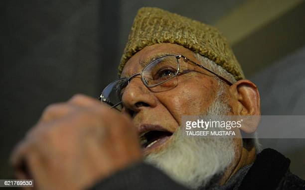 Kashmiri seperatist leader Syed Ali Shah Geelani addresses a press confrence in Srinagar on November 8 after holding a meeting with traders...