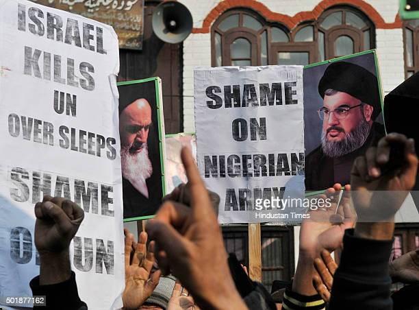 Kashmiri Shia Muslims shout slogans during a protest on December 18 2015 in Srinagar India The Shia Muslims were protesting against the killing of...