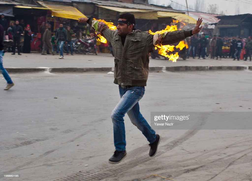 A Kashmiri Shiite mourner runs after he set himself on fire during a Muharram procession on November 23, 2012 in Srinagar, the summer capital of Indian administered Kashmir, India. Hundreds of Shiite Muslim mourners were detained by the Indian police as they tried to take part in the procession. Muslims all over the world mourn during Muharram, the first month of Islamic lunar calendar, the slaying of Imam Hussain, grandson of the Prophet Mohammed who was assassinated by his political rivals along with 72 companions in 680 AD in Iran. Shiite Muslims mourn by flagellating themselves with knives and swords. India has banned any processions and similar public gatherings in Kashmir after a rebellion against Indian rule broke out in 1989.
