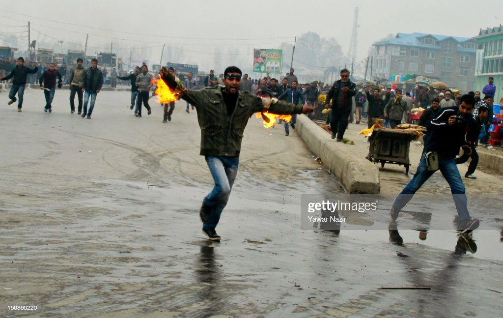 A Kashmiri Shiite mourner runs with burning cloth on his arms after he set himself on fire during a Muharram procession on November 23, 2012 in Srinagar, the summer capital of Indian administered Kashmir, India. Hundreds of Shiite Muslim mourners were detained by the Indian police as they tried to take part in the procession. Muslims all over the world mourn during Muharram, the first month of Islamic lunar calendar, the slaying of Imam Hussain, grandson of the Prophet Mohammed who was assassinated by his political rivals along with 72 companions in 680 AD in Iran. Shiite Muslims mourn by flagellating themselves with knives and swords. India has banned any processions and similar public gatherings in Kashmir after a rebellion against Indian rule broke out in 1989.