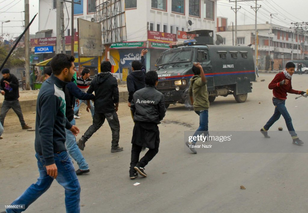 Kashmiri Shiite mourners throw stones at an Indian police after they were stopped by them during a Muharram procession on November 23, 2012 in Srinagar, the summer capital of Indian administered Kashmir, India. Hundreds of Shiite Muslim mourners were detained by the Indian police as they tried to take part in the procession. Muslims all over the world mourn during Muharram, the first month of Islamic lunar calendar, the slaying of Imam Hussain, grandson of the Prophet Mohammed who was assassinated by his political rivals along with 72 companions in 680 AD in Iran. Shiite Muslims mourn by flagellating themselves with knives and swords. India has banned any processions and similar public gatherings in Kashmir after a rebellion against Indian rule broke out in 1989.