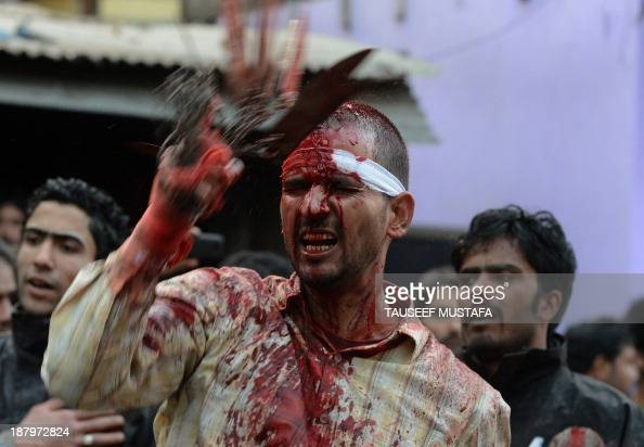 A Kashmiri Shiite Muslim devotee is covered in blood as he participates in ritual selfflagellation during a religious procession held ahead of Ashura...