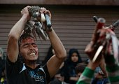 Kashmiri Shiite Muslim devotees participate in ritual selfflagellation during a religious procession held ahead of Ashura on the ninth day of...