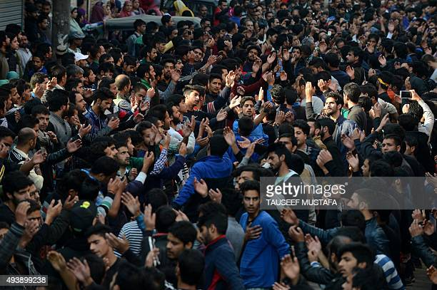Kashmiri Shiite Muslim devotees shout religious slogans during a religious procession held ahead of Ashura on the ninth day of Muharram in Srinagar...