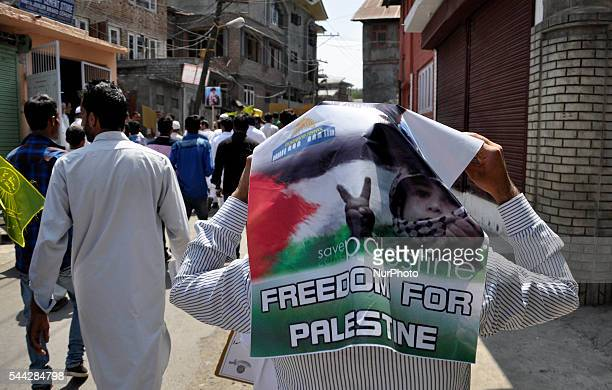 A Kashmiri Shiite Muslim Holds a proPalestinian banner card during a Quds day protest in old city Srinagar on July 12016Quds Day is marked on every...