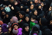 Kashmiri Shiite Muslim women look on during a religious procession marking Ashura in Srinagar on November 15 2013 Ashura mourns the death of Imam...