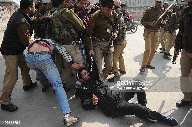 Kashmiri Shiite Muslims are detained by Indian police as devotees defy restrictions for a Muharram procession in Srinagar on October 22 2015...