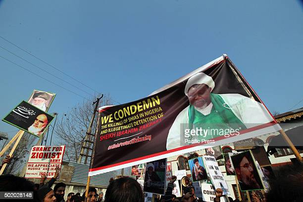 Kashmiri Shiite Muslims display placards and banner pasted with the pictures of Sheikh Ibrahim Zakzaky as they protest in Hasanabad in Srinagar the...