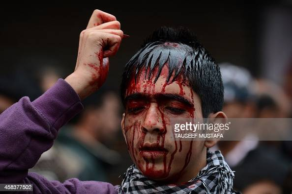 Kashmiri Shiite Muslims perform a ritual of selfflagellation with knives during a religious procession in downtown Srinagar on November 4 2014 Ashura...