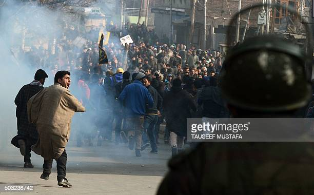 TOPSHOT Kashmiri Shiite protesters shout slogans as they run from teargas smoke during a demonstration in Srinagar on January 3 against the execution...