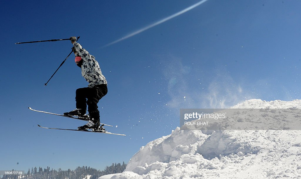 Kashmiri skier gets some air at a ski resort in Gulmarg, some 55kms west of Srinagar, on February 7, 2013. Gulmarg, situated in the foothills of the Himalayas, is regarded as one of the leading ski destinations in South Asia. Scores of foreigners visit the slopes despite an ongoing insurgency in the region. AFP PHOTO/ Rouf BHAT