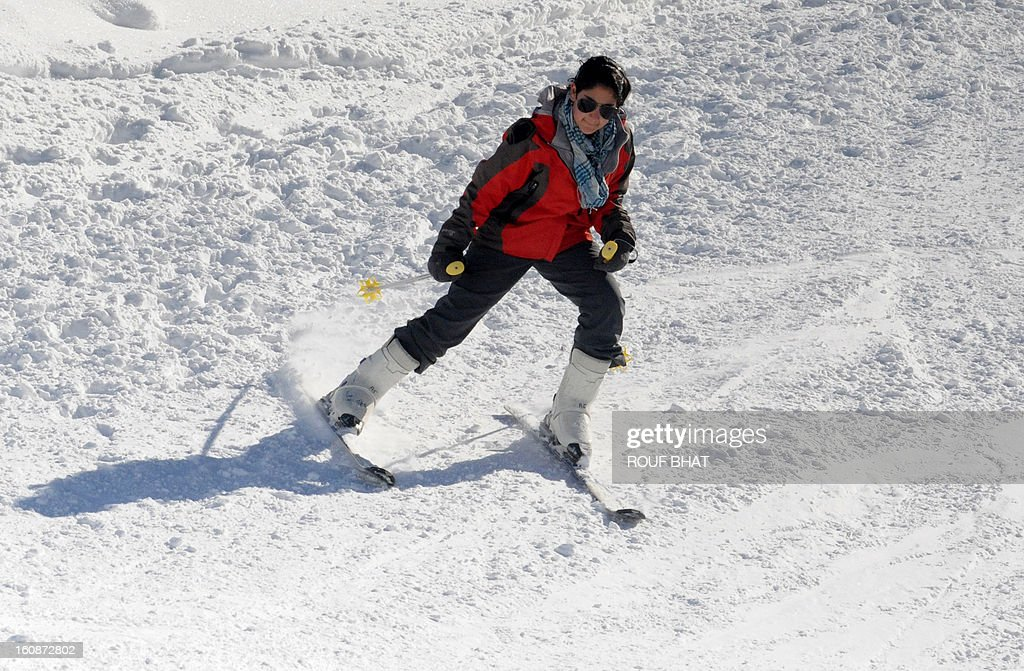 A Kashmiri skier makes her way down a slope at a ski resort in Gulmarg, some 55kms west of Srinagar, on February 7, 2013. Gulmarg, situated in the foothills of the Himalayas, is regarded as one of the leading ski destinations in South Asia. Scores of foreigners visit the slopes despite an ongoing insurgency in the region. AFP PHOTO/ Rouf BHAT