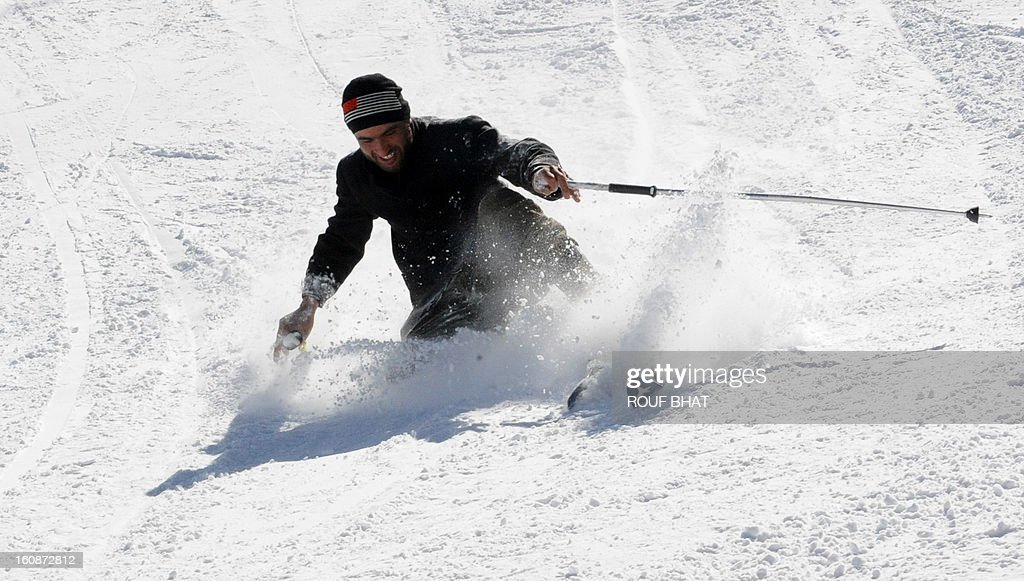 A Kashmiri skier makes his way down a slope at a ski resort in Gulmarg, some 55kms west of Srinagar, on February 7, 2013. Gulmarg, situated in the foothills of the Himalayas, is regarded as one of the leading ski destinations in South Asia. Scores of foreigners visit the slopes despite an ongoing insurgency in the region. AFP PHOTO/ Rouf BHAT