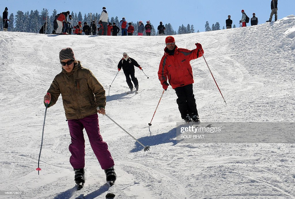 Kashmiri skiers make their way down a slope at a ski resort in Gulmarg, some 55kms west of Srinagar, on February 7, 2013. Gulmarg, situated in the foothills of the Himalayas, is regarded as one of the leading ski destinations in South Asia. Scores of foreigners visit the slopes despite an ongoing insurgency in the region. AFP PHOTO/ Rouf BHAT
