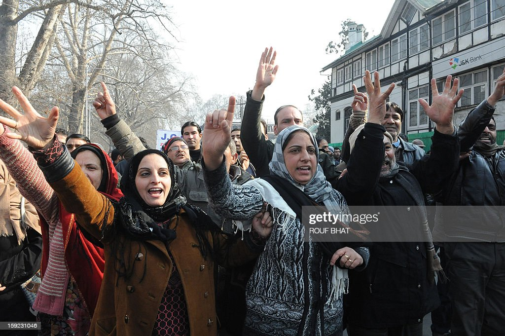 Kashmiri state government employeee shout slogans during a protest march in Srinagar on January 10, 2013. Dozens of government employees were arrested as they tried to stage a protest march in Srinagar. Local government employees began a three-day strike January 8 to build pressure on the region's government to take decision on their pending demands which include improvements on contractors wages and retirement benefits. AFP PHOTO/Rouf BHAT