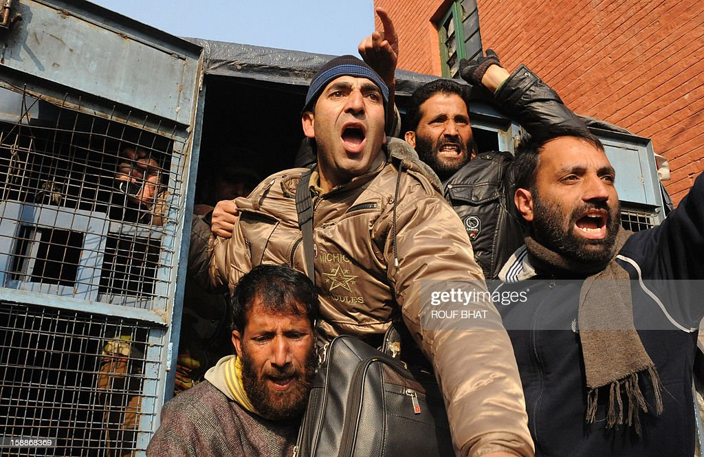 Kashmiri state government employees shout slogans after being detained by police during a protest in Srinagar on January 2, 2013. The demontrators took to the streets against the state government demanding the regularisation of contractual employees. AFP PHOTO/Rouf BHAT