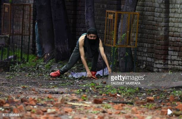 Kashmiri student prepares to throw a stone during clashes with Indian government forces in central Srinagar's Lal Chowk on April 24 2017 Police fired...