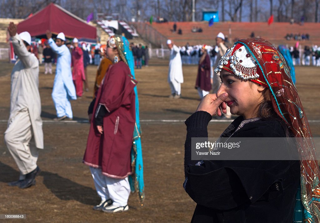 A Kashmiri student wipes her nose during a cold morning wile performing before main stream politicians and ministers during India's Republic Day celebrations on January 26, 2013 in Srinagar, the summer capital of Indian Administered Kashmir. All businesses, schools and shops were closed and traffic remained off the roads following a strike call given by Kashmiri separatist leaders against India's Republic Day celebrations in Kashmir. Meanwhile India deployed large numbers of Indian police and paramilitary forces to prevent any incidents during the official celebrations.