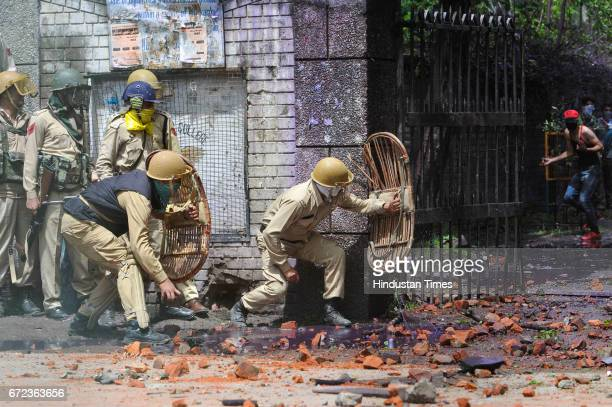 Kashmiri students clash with forces near a college at Lal Chowk area on April 24 2017 in Srinagar India