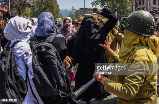 Kashmiri students clash with Indian government forces after they tried to march in the city's main commercial hub to protest the attack by Indian...