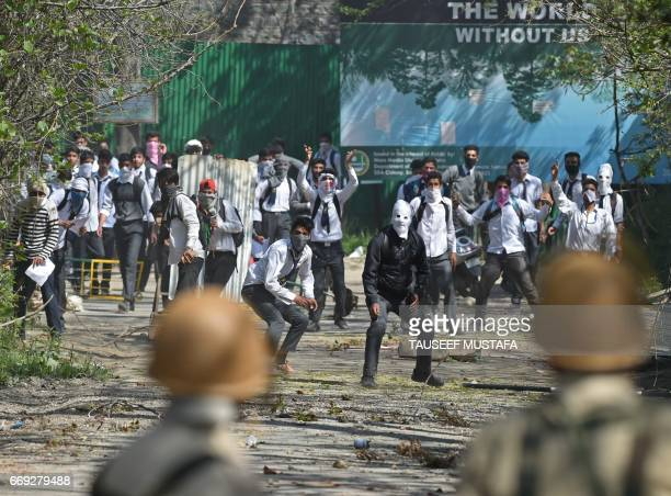 TOPSHOT Kashmiri students clash with Indian government forces near a college in central Srinagar's Lal Chowk on April 17 2017 Violence erupted in...