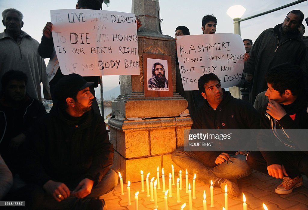 Kashmiri students participate in a candlelight vigil in Srinagar on February 17, 2013. The demonstrating students demanded the return of Afzal Guru's mortal remains to his family in Kashmir. Guru was executed on February 9, 2013 and buried inside a high security prison in New Delhi over his role in a deadly attack on Indian parliament in New Delhi in 2001. AFP PHOTO/ Rouf BHAT
