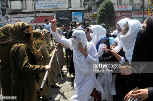 Kashmiri students shout slogans during a protest at Lal Chowk on April 17 2017 in Srinagar India Violence erupted in Srinagar as students staged a...