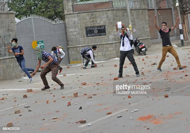 Kashmiri students through stones during clashes with Indian government forces in central Srinagar's Lal Chowk on May 9 2017 Police fired into a crowd...