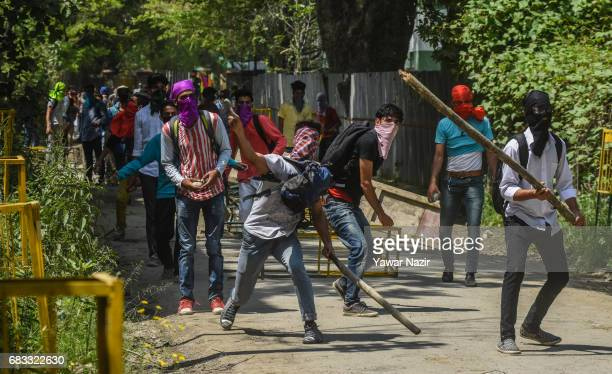 Kashmiri students throw stones at Indian government forces during a protest against an attack by Indian government forces on students on May 15 in...