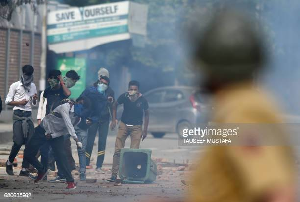 Kashmiri students throw stones during clashes between students and Indian government forces in central Srinagar's Lal Chowk on May 9 2017 Police...