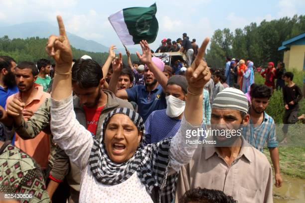 Kashmiri village woman shout proPakistani and profreedom slogans during the funeral procession of senior militant Arif Nabi Dar in Lilhar about 35...