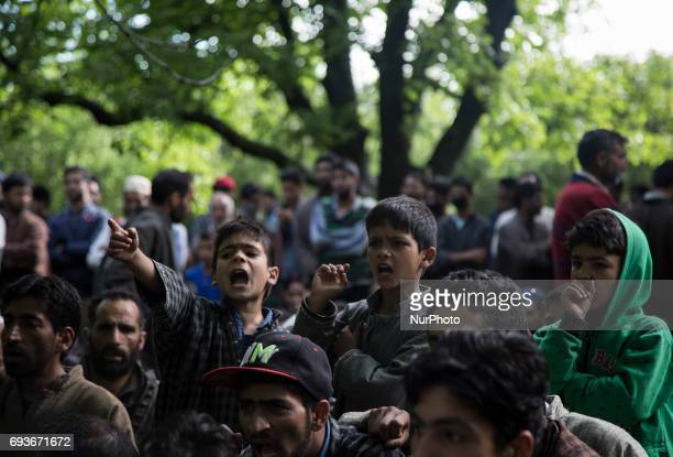 Kashmiri villager children shout profreedom slogans during the funeral of a teenager Adil Magray at Shopian about 60 kilometers south of Srinagar...