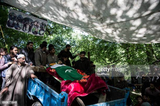 Kashmiri villagers attend the funeral of a teenager Adil Magray at Shopian about 60 kilometers south of Srinagar Indianadministered Kashmir Wednesday...