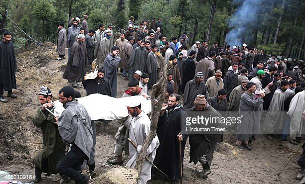 Kashmiri villagers carry a body for a funeral in the village of Laden at Chadoora on March 31 2015 some 40kms west of Srinagar India Emergency...